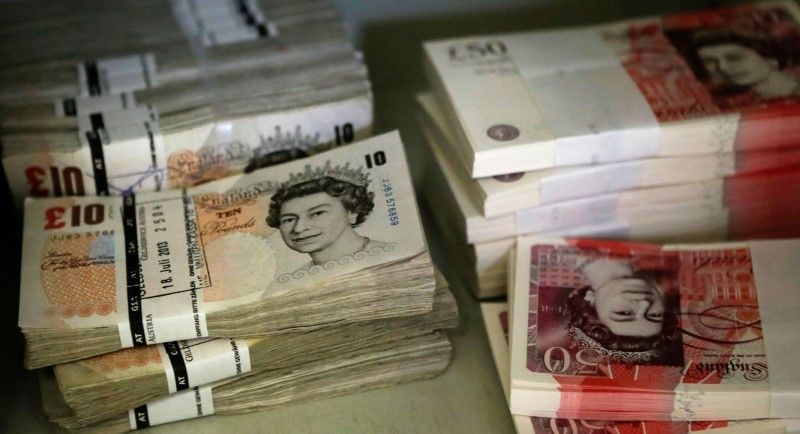 Sterling slides to three-month low in Asia on Brexit concerns