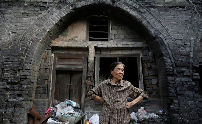 China : Undermining towns sink after mines close