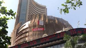 Sensex holds on to gains, Nifty above 10,400; TCS, Infosys decline
