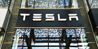 Tesla's difficult path to profit in six charts