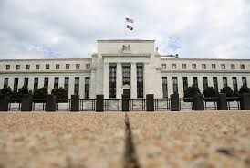 U.S. Fed cuts interest rates, signals it is on hold