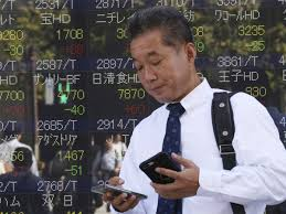 Asian shares edge down as tariff deadline hems bets